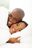 African couple sleeping Stock Images