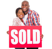 african couple sold sign Stock Photography