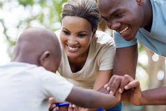 African couple son bicycle Stock Photos
