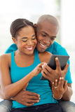 African couple tablet Stock Image