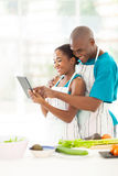 African couple tablet kitchen Stock Photos