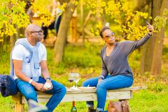 African couple taking a selfie photo at food and wine festival stock photos