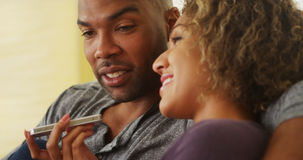 African couple talking on smartphone stock photography