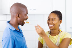 African couple tasting food Stock Photography
