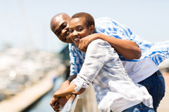 African couple vacation. Happy african american couple enjoying their vacation by the harbor Royalty Free Stock Photo
