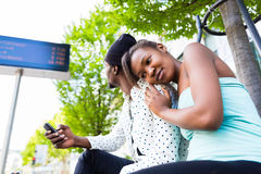 African couple waiting at bus station Stock Photography