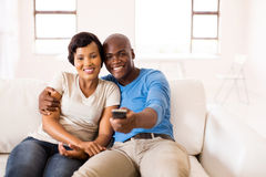 African couple watching movie Royalty Free Stock Photography