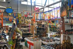 African Curio Market. A wide range of colorful handmade items for sale in an indoor curio market Stock Photos