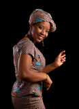 African dance. Young Ghanese african woman showing a dance in her traditional national costume Stock Images