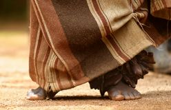 African dancer. Feet of an african traditional dancer with wooden percussion on the ankle Stock Photography