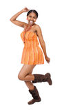 African dancer. Beautiful young African woman with braids dancing Stock Image