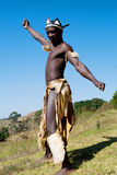 African dancer. South African zulu tribe man dressed in traditional clothes dancing on wild mountain Stock Photography