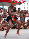 African Dancer entertains crowds at Ironman. An African dancer entertains the crowds at Ironman 2008. Ironman South African was held in Port Elizabeth on the 13 Royalty Free Stock Image