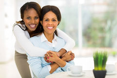African daughter hugging mother Royalty Free Stock Photos