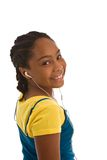 African descent adolescent with earbuds on Royalty Free Stock Photo