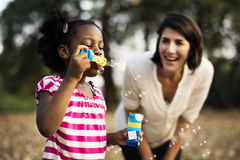 African descent girl is playing bubbles stock image