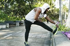 Free African Descent Man Stretching At The Park Royalty Free Stock Image - 108017226
