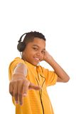 African descent teenager wearing headphones Royalty Free Stock Images