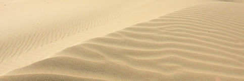 African desert dunes. Like ocean waves Royalty Free Stock Images