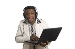 African DJ with notebook and head phones Stock Photo