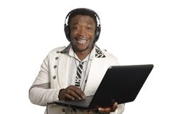 African DJ with notebook and head phones stock photography