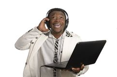 African DJ with notebook and head phones Royalty Free Stock Photo