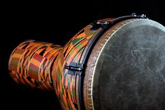 African Djembe on Black Bk. An orange African Djembe isolated on Black Background in the horizontal or landscape view Royalty Free Stock Photo