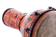 African Djembe Conga Drum. An orange African or Latin Djembe conga drum isolated on white background in the horizontal format with copy space Royalty Free Stock Image