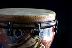 African Djembe Drum Black Bk. African djembe conga drum isolated closeup on its side against a black background in the horizontal format with copy space Royalty Free Stock Photography