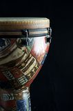 African Djembe Drum Black Bk. AAn African or latin djembe or conga  drum isolated against a black  background in the  vertical format with copy space Royalty Free Stock Photography