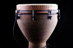 African Djembe Drum Black Bk. A brown African djembe drum isolated on a black background in the horizontal or landscape view Royalty Free Stock Image
