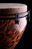 African Djembe Drum Black Bk. An orange  African djembe drum isolated on a black background in the vertical or portrait view Stock Image