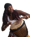 African Djembe Drummer. An African American plays the djembe drum, set against a white background Stock Photo