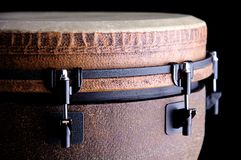 African Djembe Isolated on Black. A brown African or Latin Djembe conga drum isolated on black background in the horizontal format with copy space Royalty Free Stock Images
