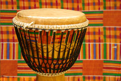 African djembe with Kente cloth Royalty Free Stock Image