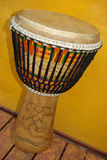 African djembe with Kente cloth. Traditional Kente cloth from Ghana used to decorate Ghanese drum Stock Images