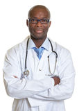 African doctor with crossed arms looking at camera Stock Photography