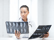 African doctor looking at x-rays Stock Photography