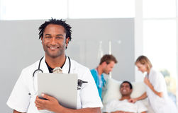 African doctor with a patient in the background Stock Images
