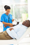 African doctor senior patient Stock Photo