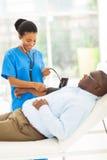 African doctor senior patient Stock Photo