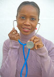 African Doctor smiling at patient. An image of an African Doctor with stethoscope smiling at the patient Royalty Free Stock Photo