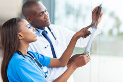 African doctors x-ray. African doctors looking at patient's x-ray at hospital Stock Photos