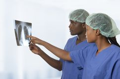 African doctors watching x-ray image of lungs Royalty Free Stock Photo