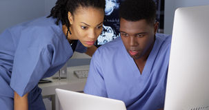 African doctors working hard in the office Stock Image