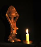 African Doll. African Wooden Figure, Praying Before the Stock Photography