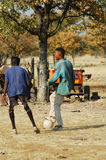 African dreams #2. Football player practising his skills on a makeshift football pitch, Namibie, Southern Africa Stock Photos