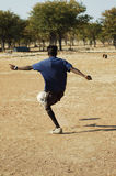 African dreams. Football player practising his skills on a makeshift football pitch, Namibie, Southern Africa Stock Images