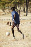 African dreams #6. Football player practising his skills on a makeshift football pitch, Namibie, Southern Africa Stock Photography