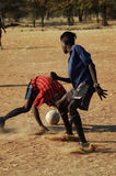 African dreams #7. Football player practising his skills on a makeshift football pitch, Namibie, Southern Africa Stock Photos